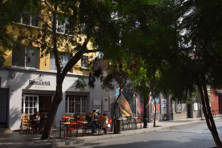 street with trees and cafes in Lastarria