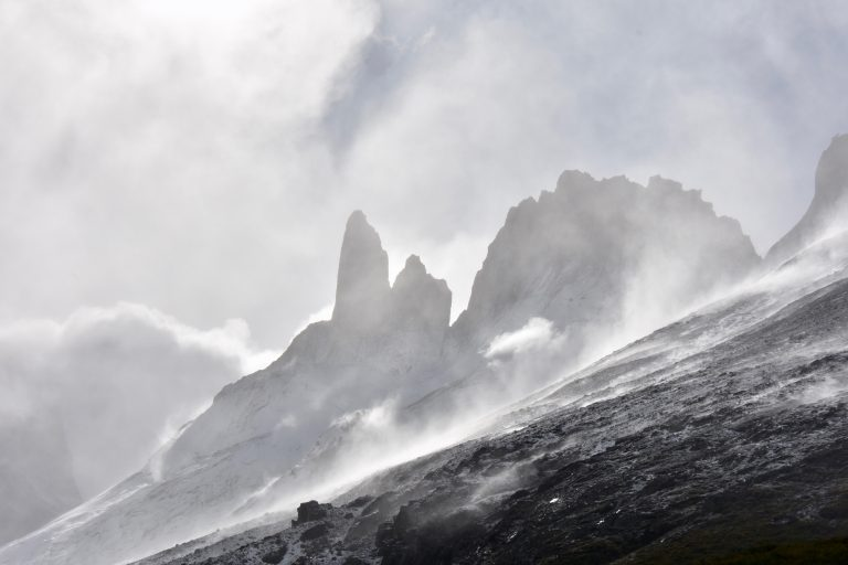mountain peaks in snow and wind
