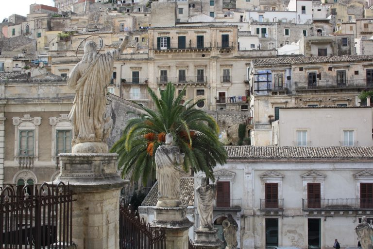 statues and houses in modica